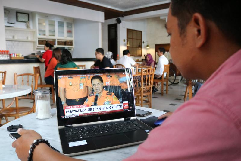 Lion Air JT 610 Falls in Indonesia. A resident watched the live broadcast of the fall of Lion Air JT 610 on a laptop in Makassar, Indonesia, Monday, October 29 stock photography