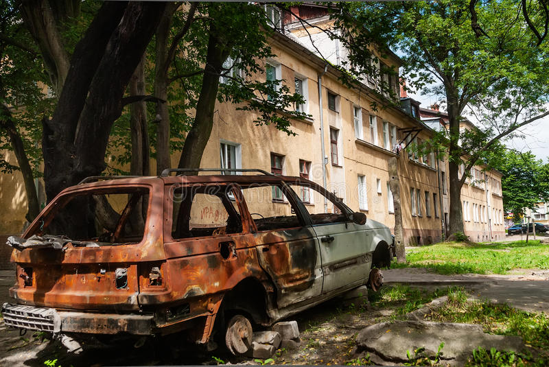 Residental House And Burned-down Vehicle Stock Photos