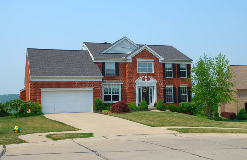 Residential 2-story brick home. In an upscale suburban neighborhood stock photo