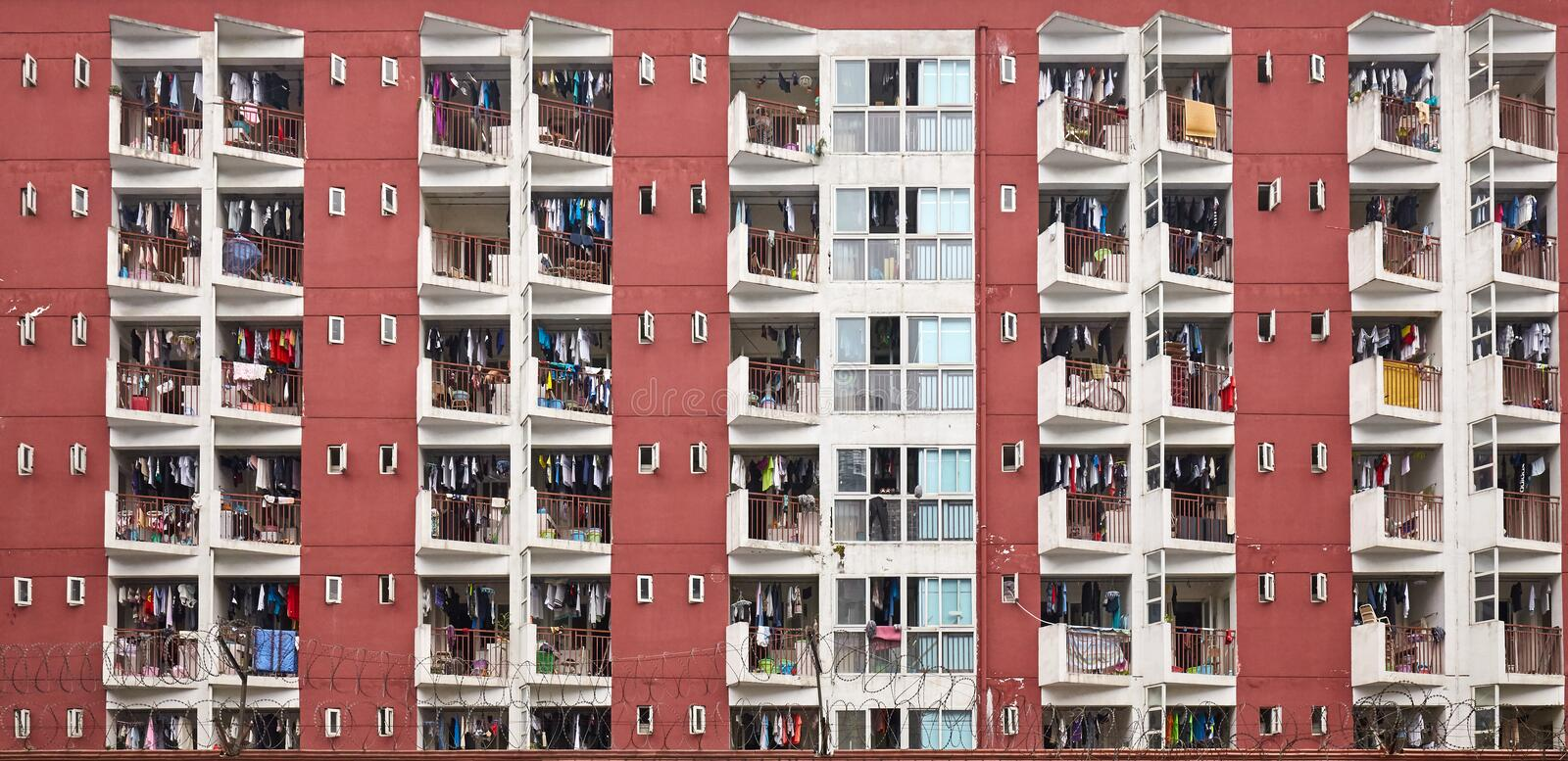 Residential apartment building with drying laundry on balconies. royalty free stock photo