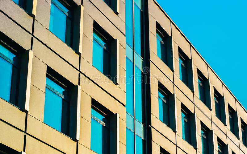 Residential apartment home facade with blank place for copy space. Residential apartment home facade with a blank place for the copy space. Blue sky on the stock photo