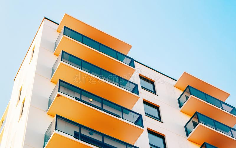 Residential apartment home facade and blank place for copy space. Residential apartment home facade and a blank place for the copy space. Blue sky on the royalty free stock photography