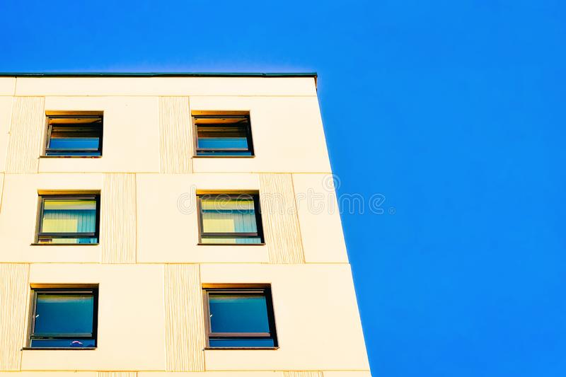 Residential apartment home facade and empty place for copy space. Residential apartment home facade and an empty place for the copy space. Blue sky on the royalty free stock photos