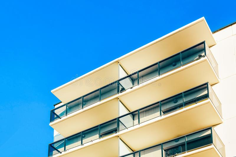 Residential apartment home facade with empty place for copy space. Residential apartment home facade with an empty place for the copy space. Blue sky on the stock images