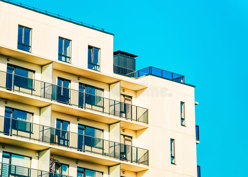 Residential apartment house facade and blank copy space. Residential apartment house facade and an blank copy space. Blue sky on the background stock photography