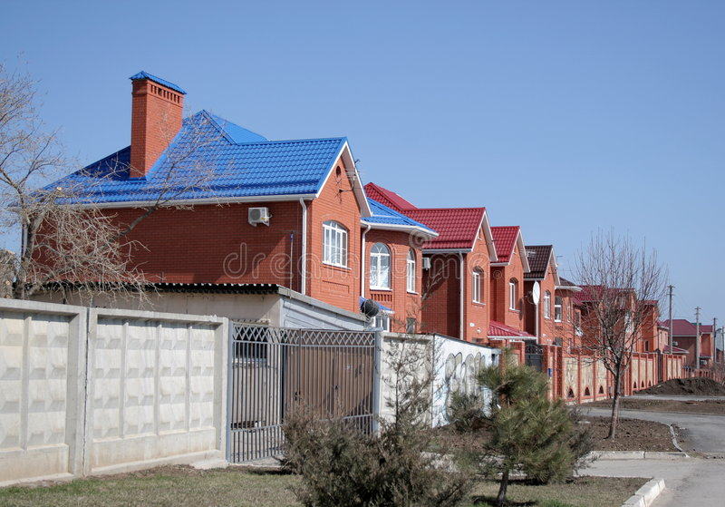 Residential area. Houses with blue roofs in the residential area stock image