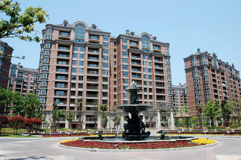 Residential area. Luxurious residential area with fountain, greens and flowers stock photography