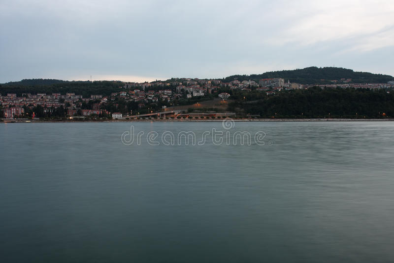 Residential area on coastline, city Koper in Slovenia in the eve. Ning royalty free stock images