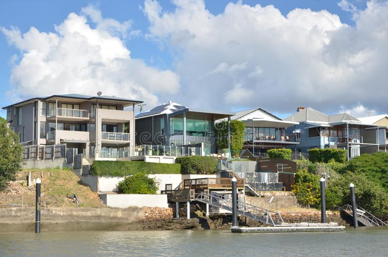 Luxuries modern houses along a river in Brisbane. Australia. Residential area on river side. Brisbane. Australia royalty free stock photo