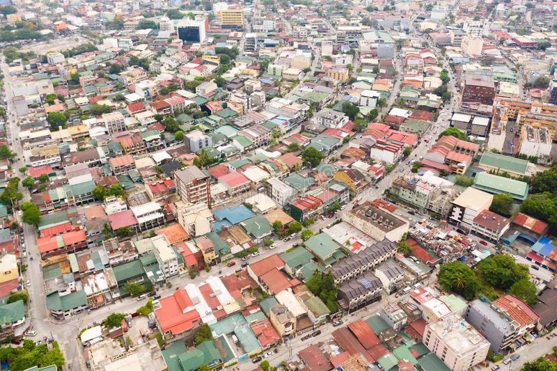 Residential areas and streets of Manila, Philippines, top view. Roofs of houses and roads. Philippine capital royalty free stock photography