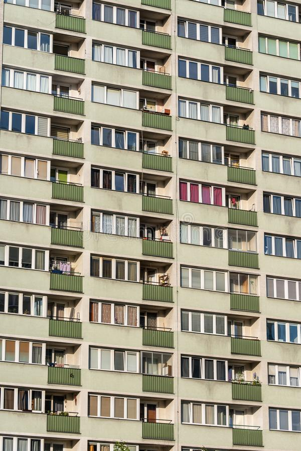 Residential Block of Flats Background. Or texture, concrete prefab multi-family building with balconies in Warsaw, Poland stock image