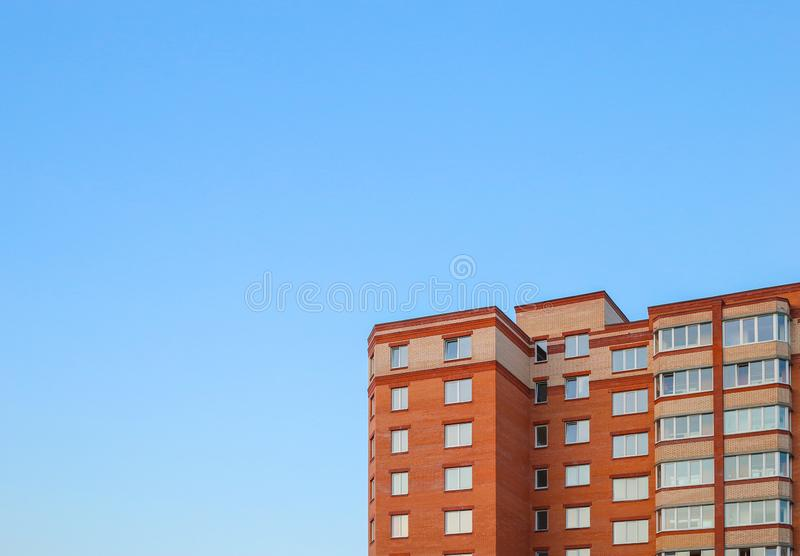 Residential building against the sky. Building. New buildings. Red brick. Copy space for text. Residential building against the sky. Building. New buildings. Red royalty free stock photography