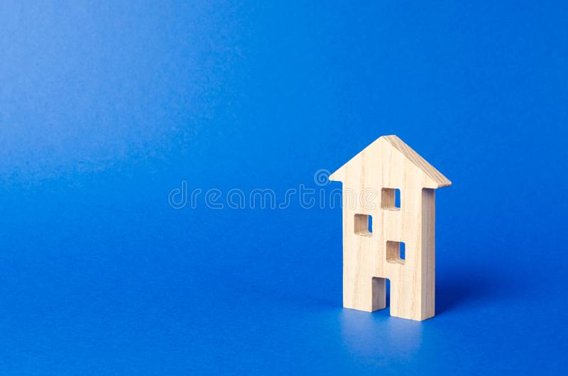 A residential building figurine. The concept of buying and selling real estate, renting. Search for a Apartment house. Affordable. Housing, credit and loans royalty free stock photo