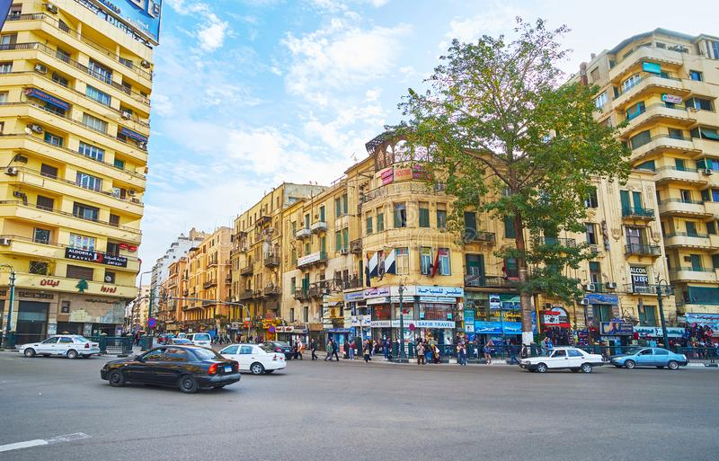 Residential buildings in Midan Tahrir, Cairo, Egypt. CAIRO, EGYPT - DECEMBER 24, 2017: The residential high-rises around Midan Al Tahrir square with small shops royalty free stock images