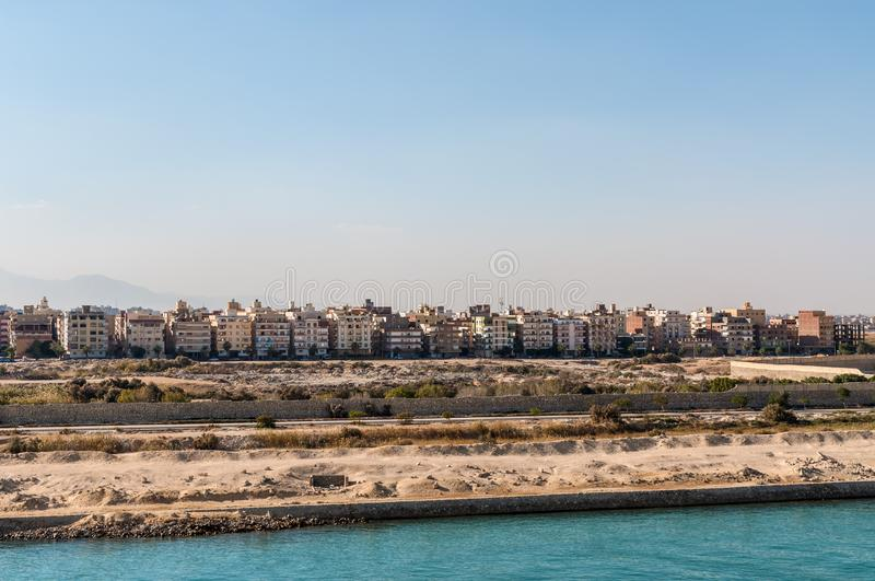 Residential buildings on the shore of Suez Canal in Egypt. Suez, Egypt - November 5, 2017: Residential buildings on the shore of Suez Canal in Egypt, Africa royalty free stock images