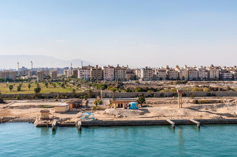 Residential buildings on the shore of Suez Canal in Egypt. Suez, Egypt - November 5, 2017: Residential buildings on the shore of Suez Canal in Egypt, Africa royalty free stock photos