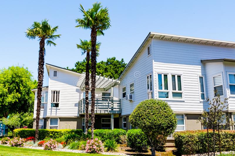 Residential buildings surrounded by trees and hedges; Sunnyvale, San Francisco bay area, California royalty free stock photography