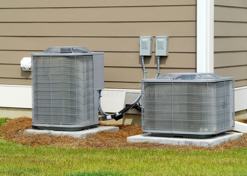 Residential A/C units. A/C units connected to residential house royalty free stock photos