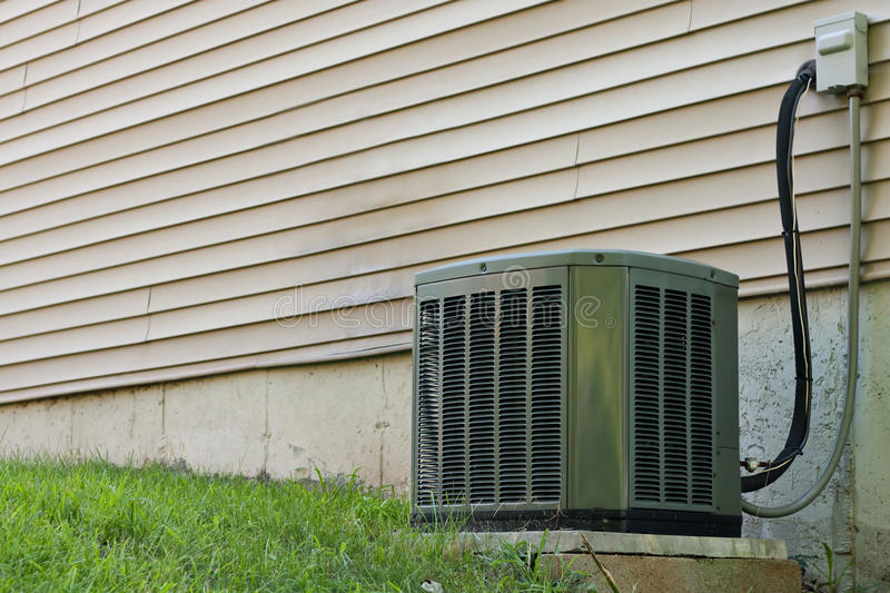 Residential Central Air Conditioner Unit royalty free stock photo