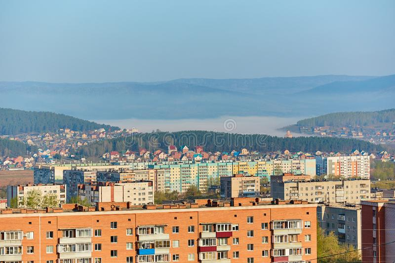 Residential complex in the Northern part of Miass, Russia. In the background, the Ural mountains, Ilmen ridge and the village of. Turgoyak, near lake Turgoyak stock image