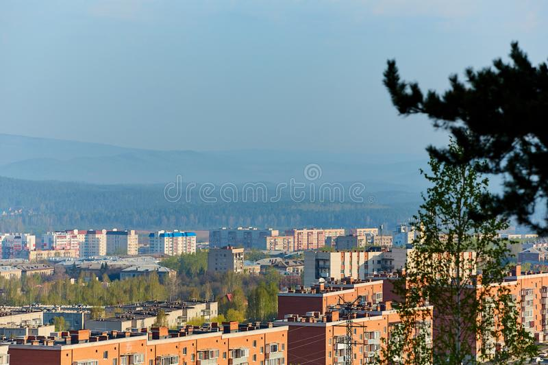 Residential complex in the Northern part of Miass, Russia. In the background, the Ural mountains, Ilmen ridge and the village of. Turgoyak, near lake Turgoyak stock photo