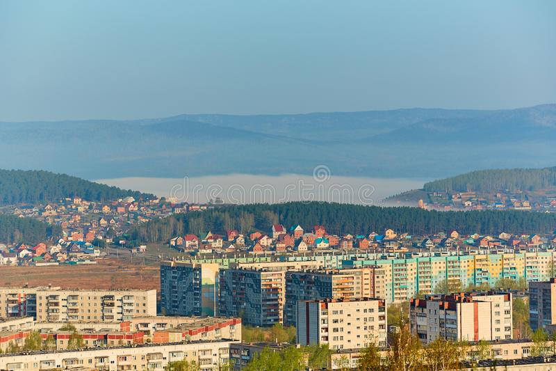 Residential complex in the Northern part of Miass, Russia. In the background, the Ural mountains, Ilmen ridge and the village of. Turgoyak, near lake Turgoyak royalty free stock photos