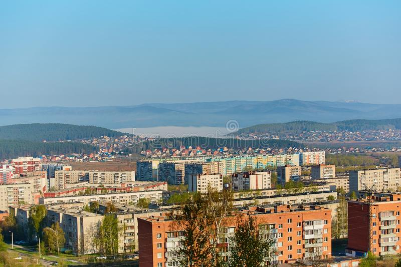 Residential complex in the Northern part of Miass, Russia. In the background, the Ural mountains, Ilmen ridge and the village of. Turgoyak, near lake Turgoyak royalty free stock image