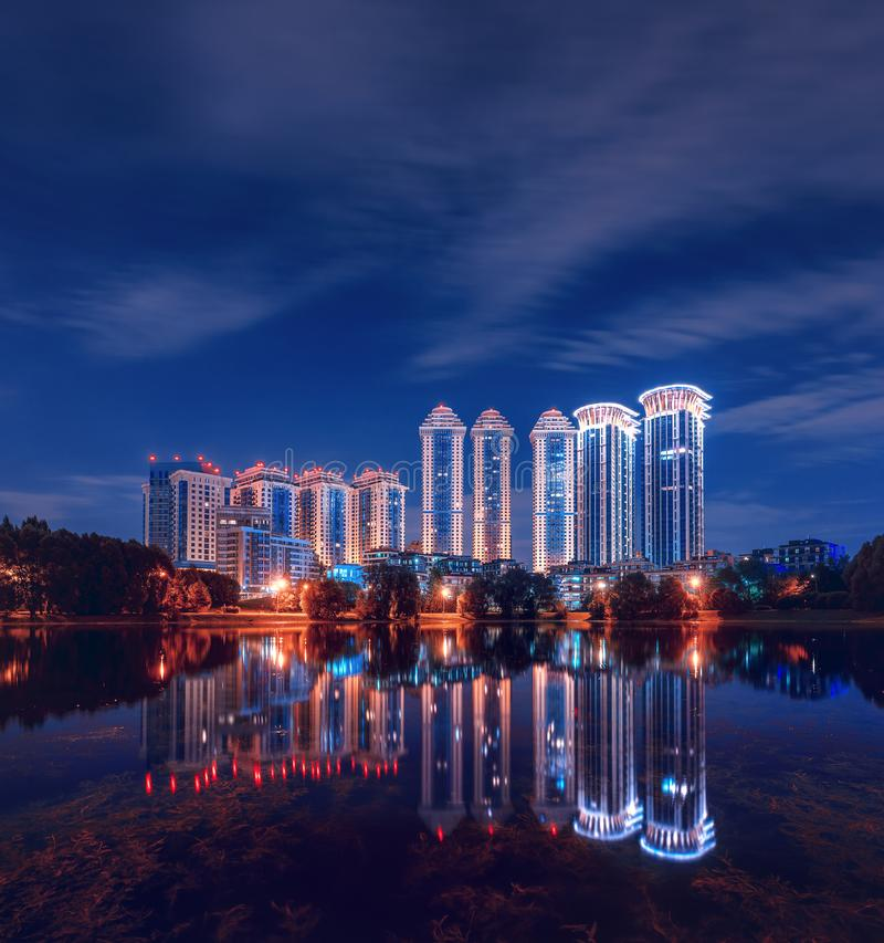 Residential complex `Valley Setun`, Housing Complex `Vorobyovy Gory` and Mosfilmovsky pond at night. District Ramenki stock photos
