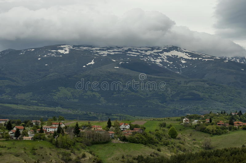 Residential district of bulgarian village Plana in forest and various trees with new leaf and blossom at springtime. Plana mountain, Bulgaria stock images