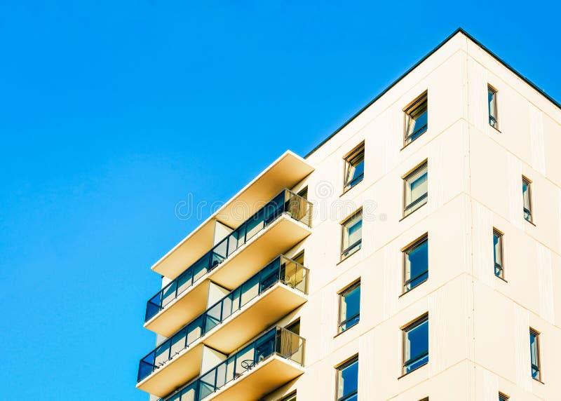 Residential EU apartment house facade with blank copy space. Residential EU apartment house facade with an blank copy space. Blue sky on the background stock photos