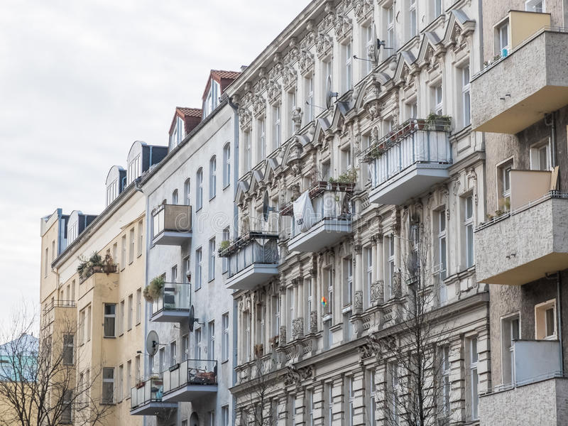 Residential flats with balconies. Residential apartment flats with balconies and classic architectural design under overcast daylight stock photo
