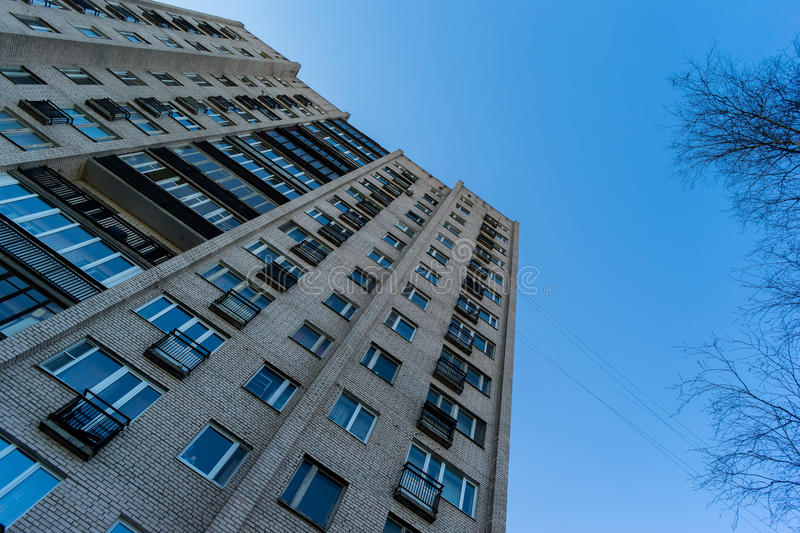Residential house on blue sky background. Block of flats from soviet times.  royalty free stock photos