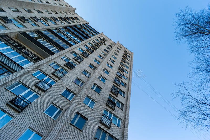 Residential house on blue sky background. Block of flats from soviet times.  stock photo