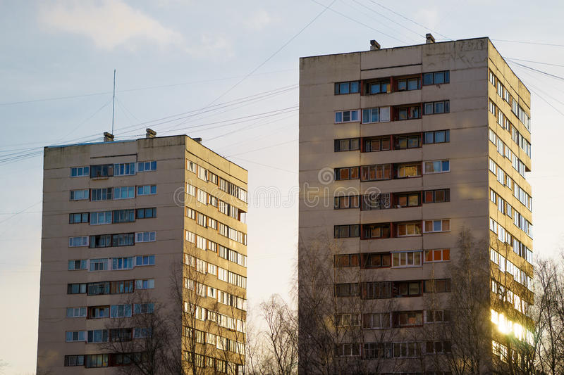 Residential house on blue sky background. Block of flats from soviet times.  royalty free stock images