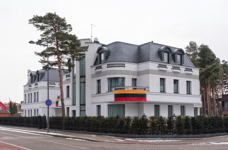 Residential house decorated with a national flag of Lithuania, Palanga resort royalty free stock photo
