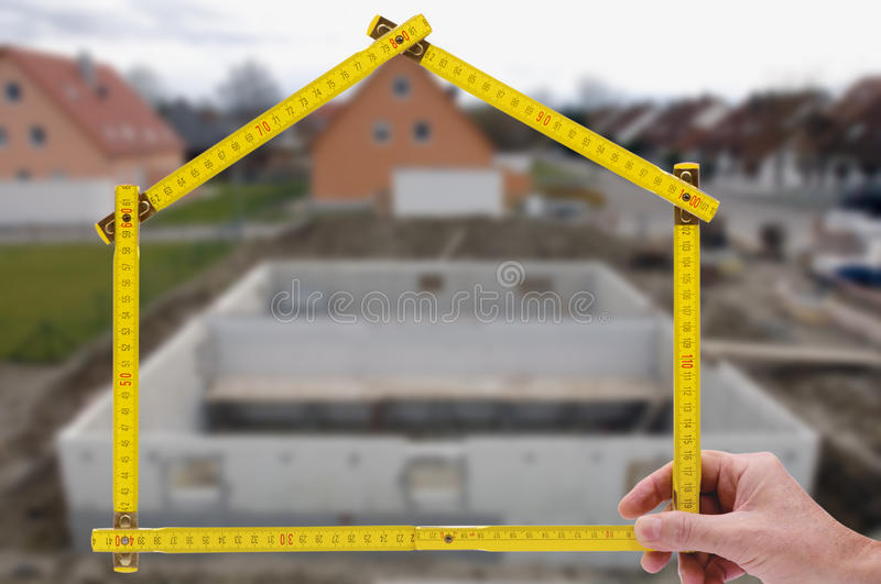 Residential house for sale. Residential house shown through an folding rule of an real estate agent royalty free stock photos