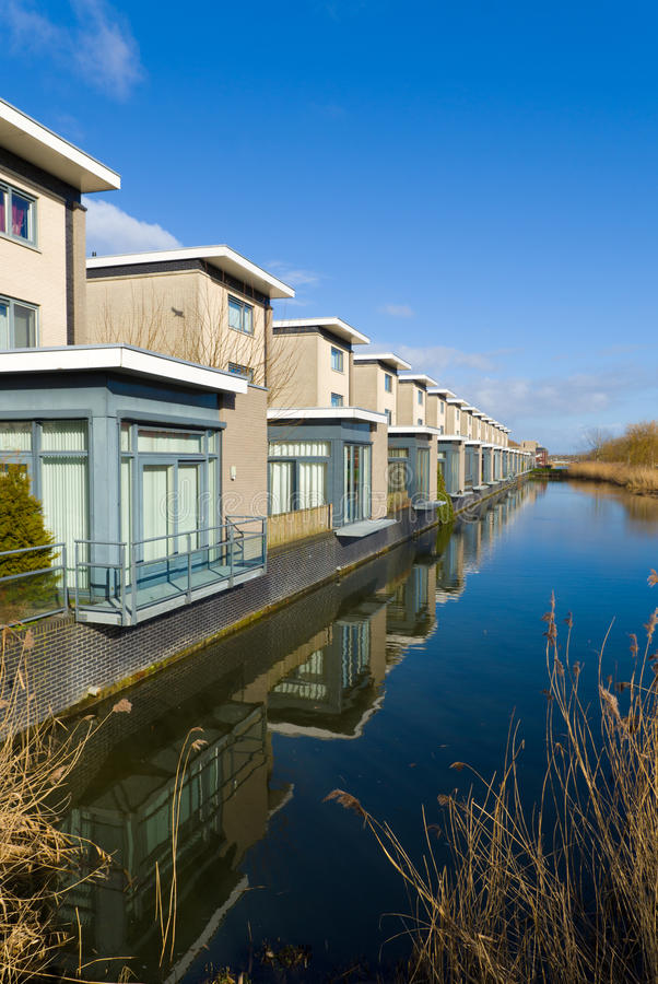 Residential houses. Modern residential houses along a canal in almere, netherlands stock images