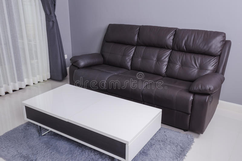 Residential interior of modern living room with sofa stock photo