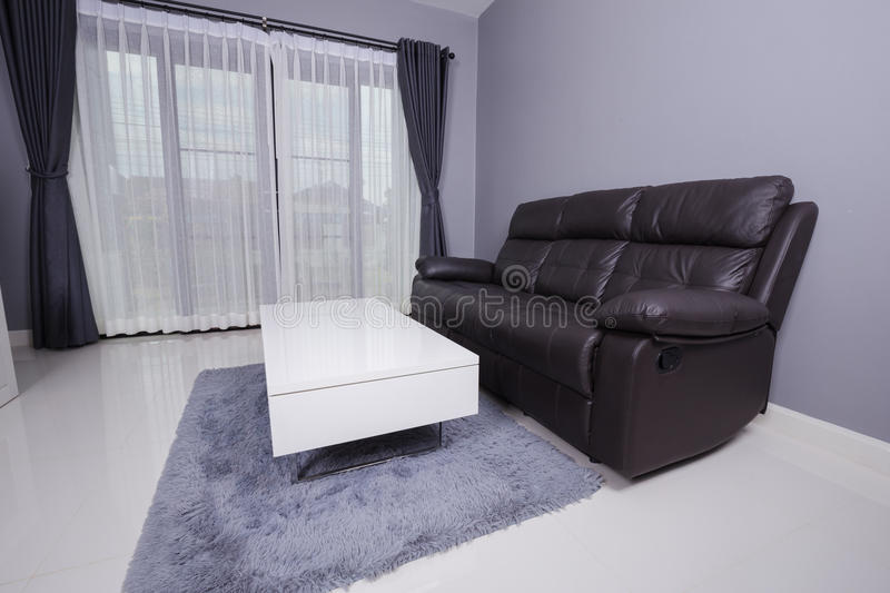 Residential interior of modern living room with sofa stock images