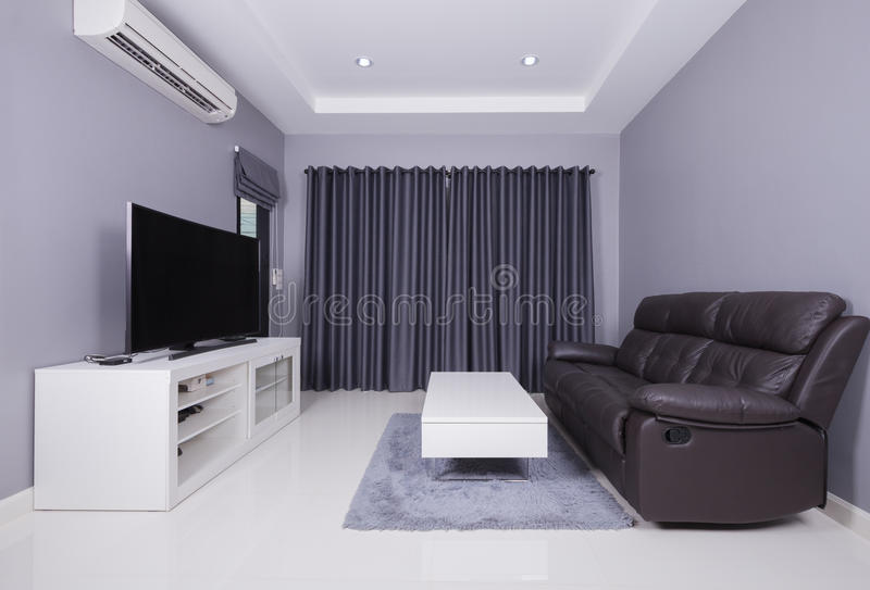 Residential interior of modern living room with sofa and TV royalty free stock photography