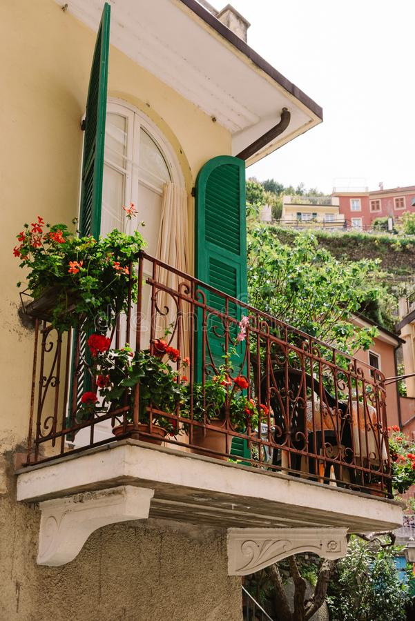 Residential old house in Italy. Stylish balcony of an Italian house with potted flowers royalty free stock photos