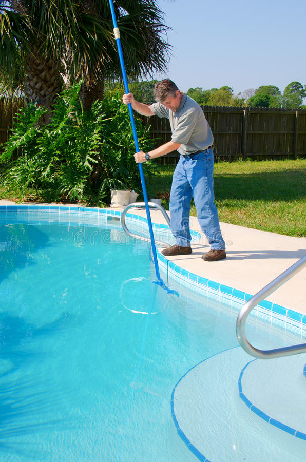 Pool Cleaning Service : Residential pool cleaning service man working stock photo