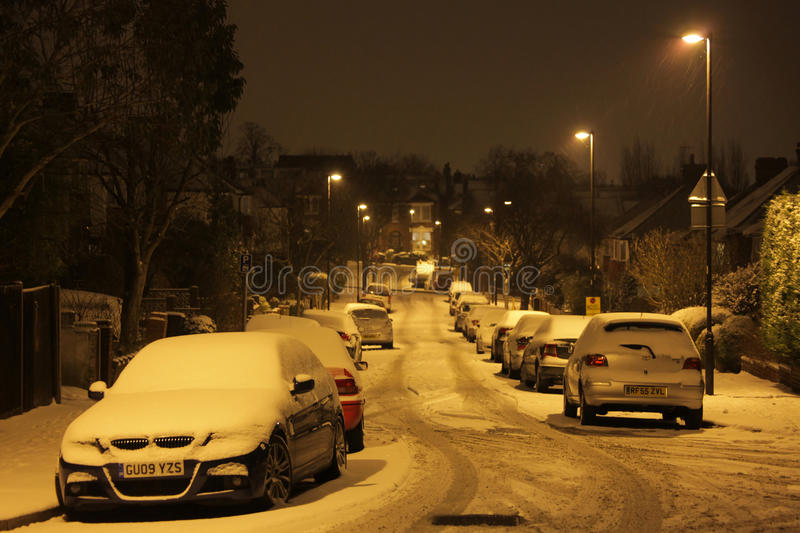 Residential road in winter. Cars parked on a quiet residential road in winter at night, London stock images