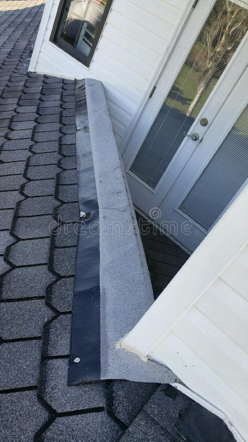Before Residential roofing repairs performed; coping; flashing. Residential roofing repairs, shingle roof, coping, flashing replacement stock images