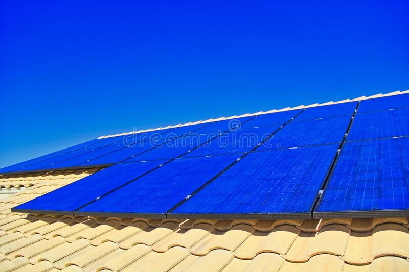 Residential rooftop solar energy and electricity generating production system. Blue silicon, photovoltaic solar panel grid. royalty free stock photos