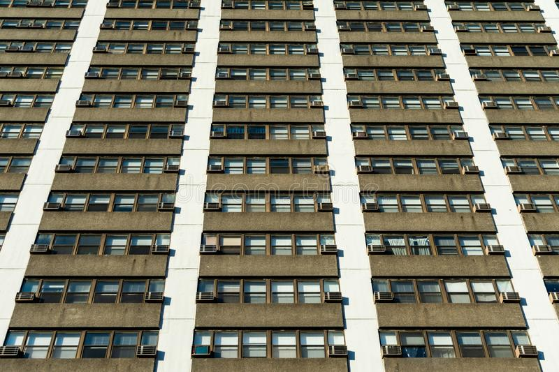 Residential Skyscraper Exterior View looking Upwards with Windows and Air Conditioning Units stock images