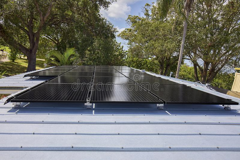 Residential Solar Panels. Solar panels mountain on a residential metal roof stock image