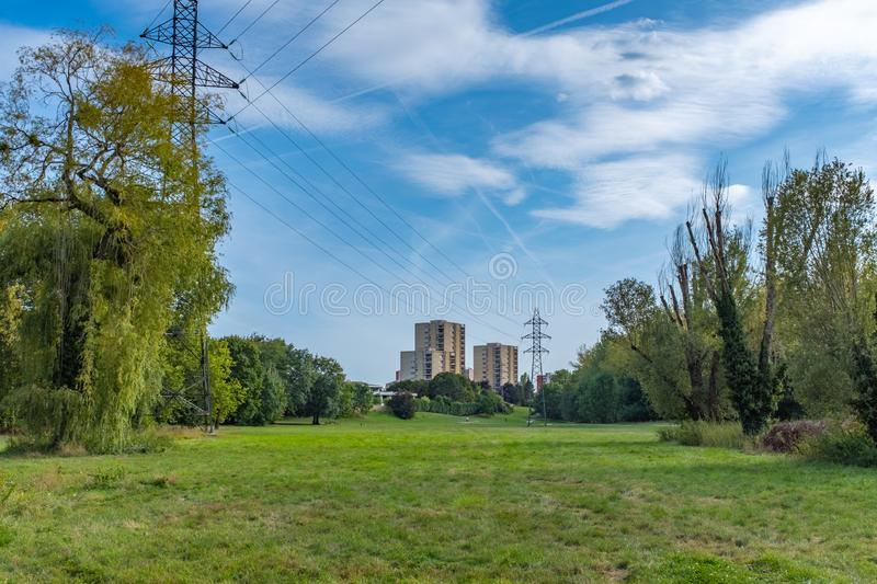 Residential tower and pylons in a green suburb stock photo