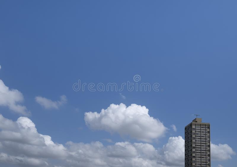 Residential Tower. Set against a blue sky on a sunny day royalty free stock image