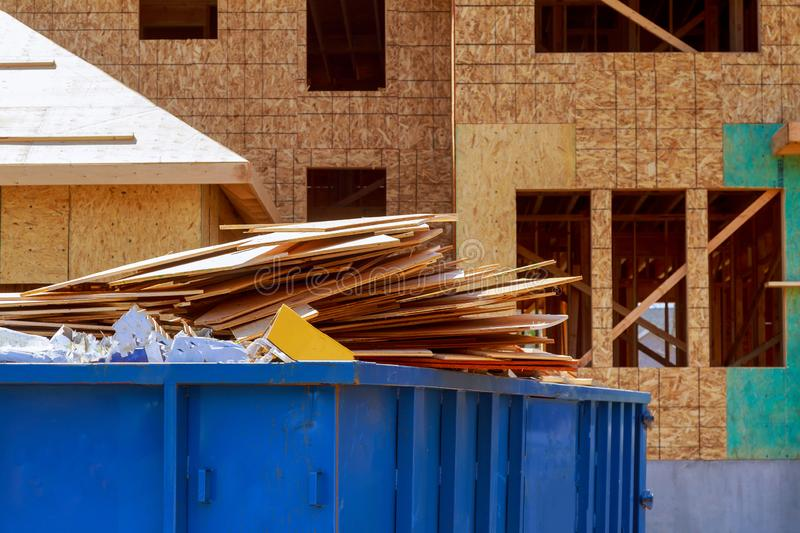 Residential view of new houses being built and construction garbage. Large container industrial bin dumpster ecology pollution industry building waste stock photo